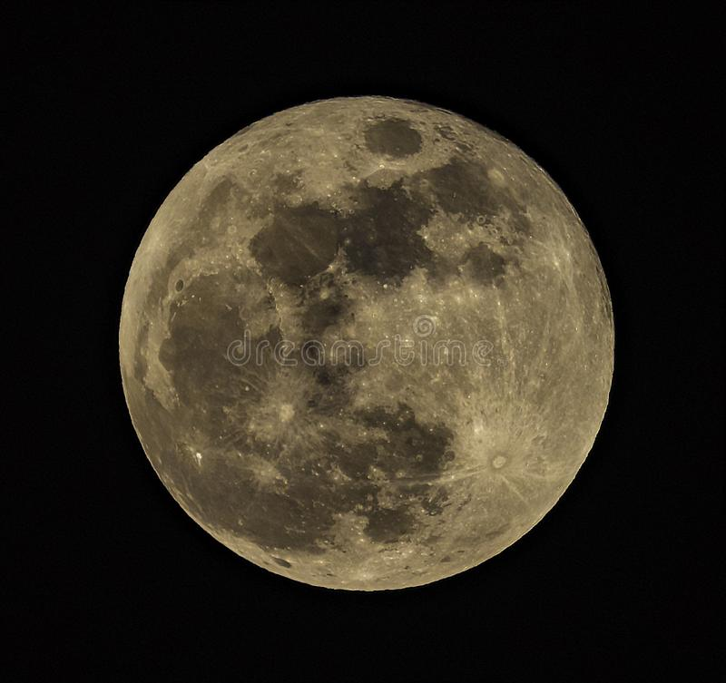 Super moon set against back night sky stock photography