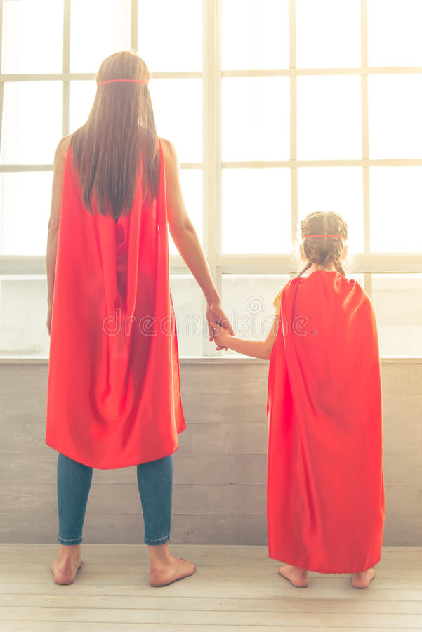 Super mother and daughter stock image