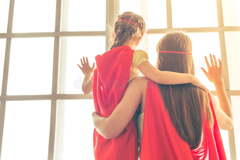 Super mother and daughter royalty free stock photo