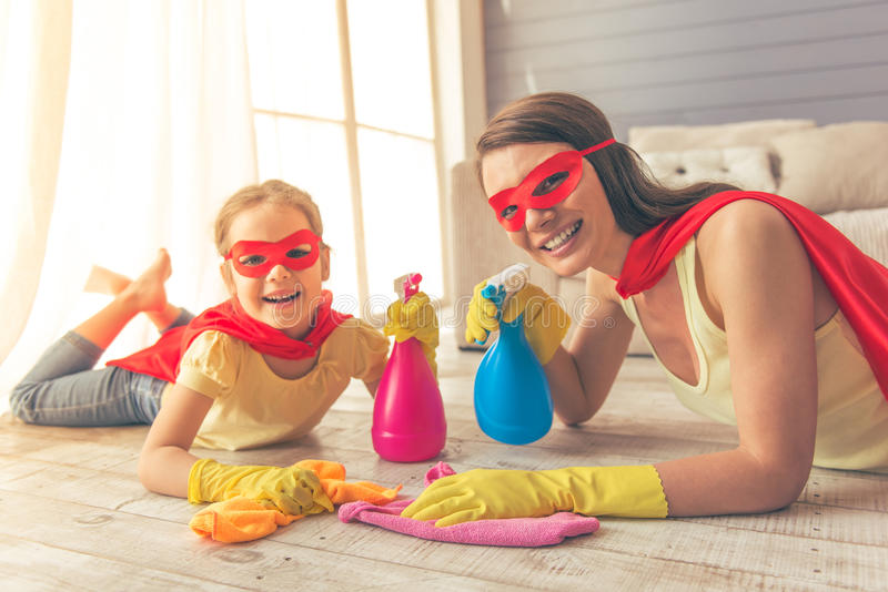 Super mother and daughter stock photos