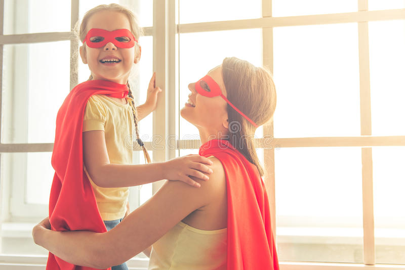 Super mother and daughter royalty free stock image