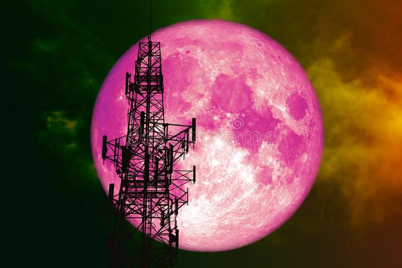 super pink moon back silhouette Antenna night red cloud on sky royalty free stock image
