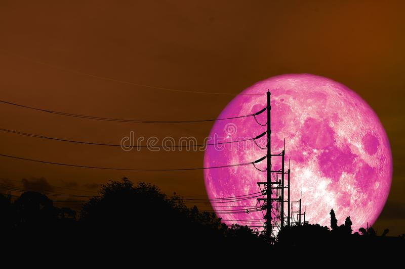 super pink moon floats in night sky above the shadow of an elect royalty free stock photos