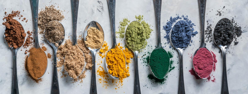 Super powders in spoons - matcha, turmeric, ginger, cocoa, spirulina, chia, cinnamon, black sesame royalty free stock image