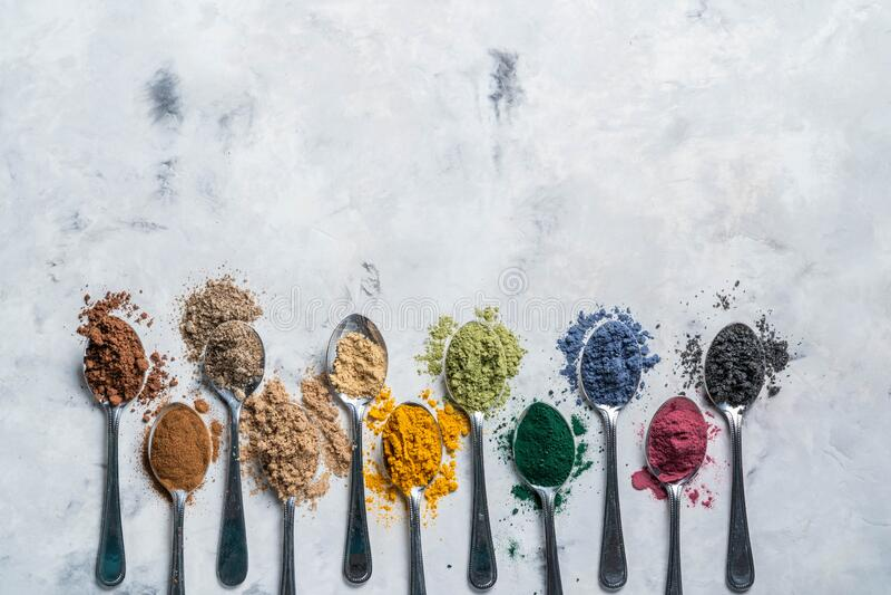 Super powders in spoons - matcha, turmeric, ginger, cocoa, spirulina, chia, cinnamon, black sesame royalty free stock photography