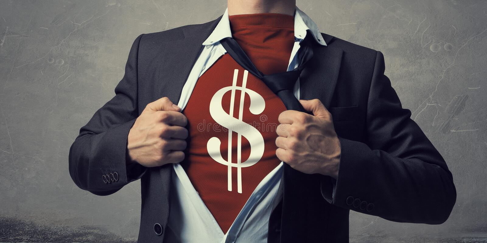 He is super and powerful. Businessman opening his chest and acting like super hero royalty free stock photos