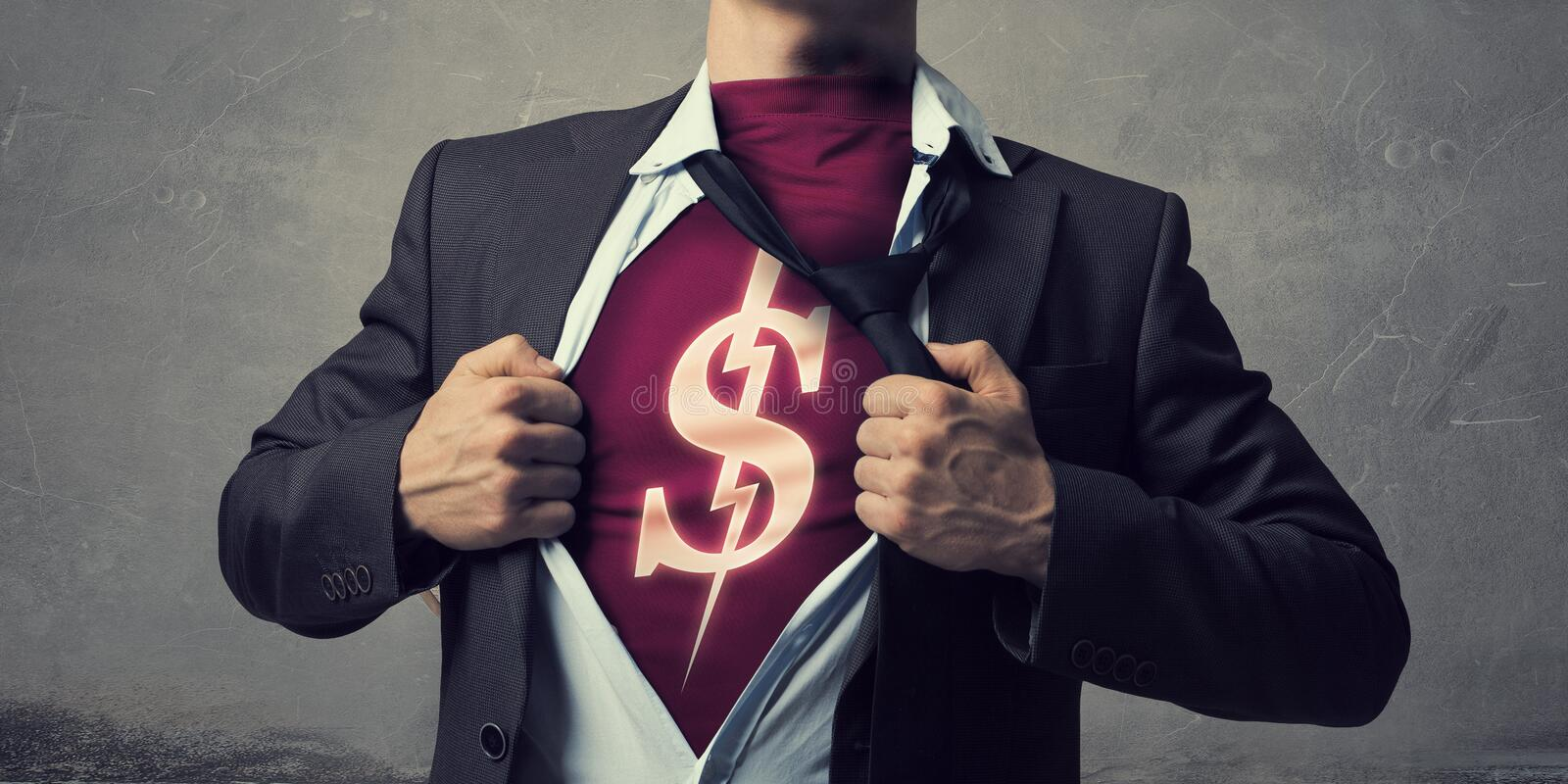 He is super and powerful. Businessman opening his chest and acting like super hero stock images