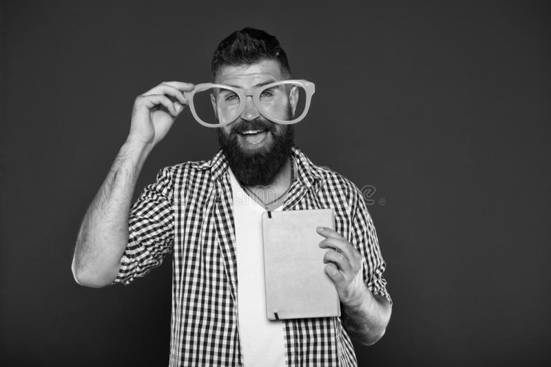 Super smart. University male student with lecture notes. Book nerd wearing fancy glasses. Bearded man in party glasses royalty free stock image