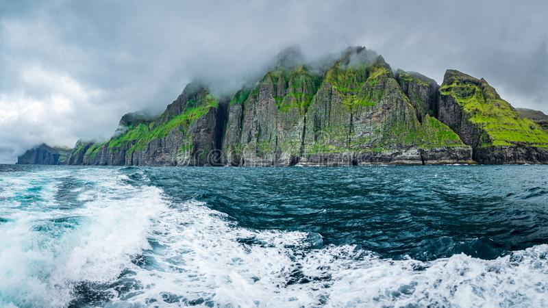 Vestmanna cliffs spectacular panorama in the Faroe Islands. Super spectacular panorama of Vestmanna cliffs in the Faroe Islands from the ocean stock photos