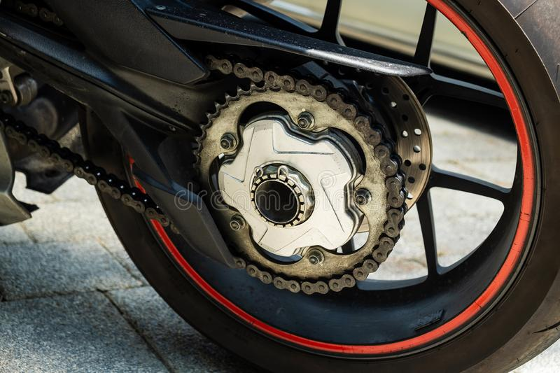 Super Sport Bike, Superbike Single-Side Motorcycle Swingarm. Close up on Driven Gear and Chain on Sigle side Swingarm stock images