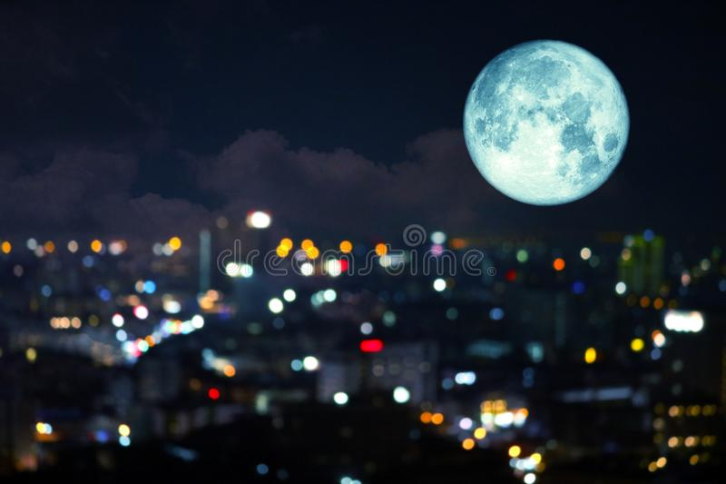 Super super full harvest moon on night sky and reflection light of city on window. Elements of this image furnished by NASA, apogee, back, background, blood royalty free stock photography