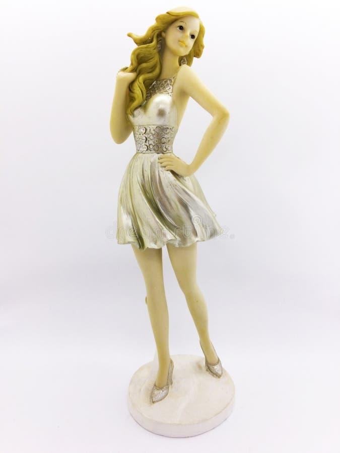 Super vorbildliche Harzpuppe mit goldenen kurzen Kleidern für Dekoration stockbild