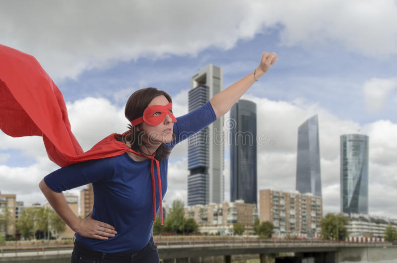 Super woman hero with red cape and mask in Madrid. Super woman hero with red cape and mask in Madrid, Spain stock image