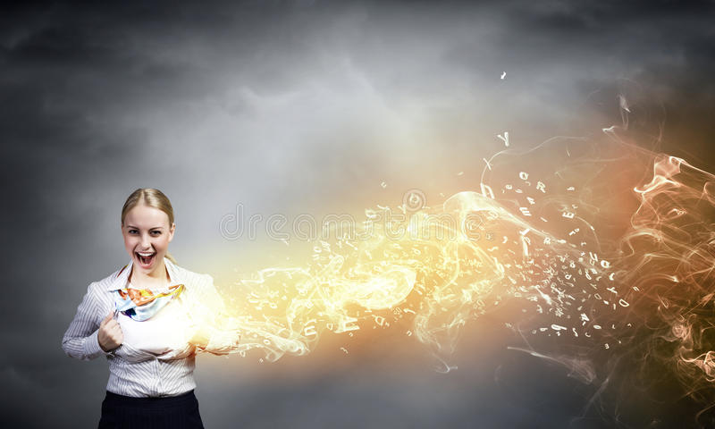 Super woman. Young woman tearing shirt on chest. Creativity concept stock photos