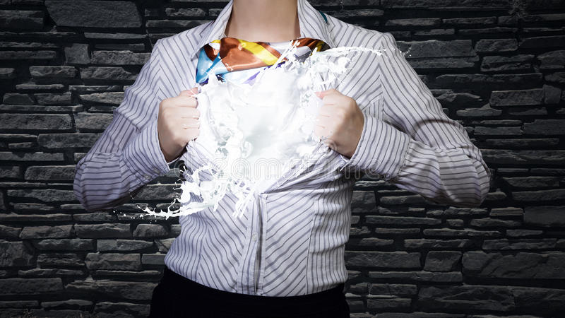 Super woman. Young woman tearing shirt on chest. Idea concept royalty free stock photography
