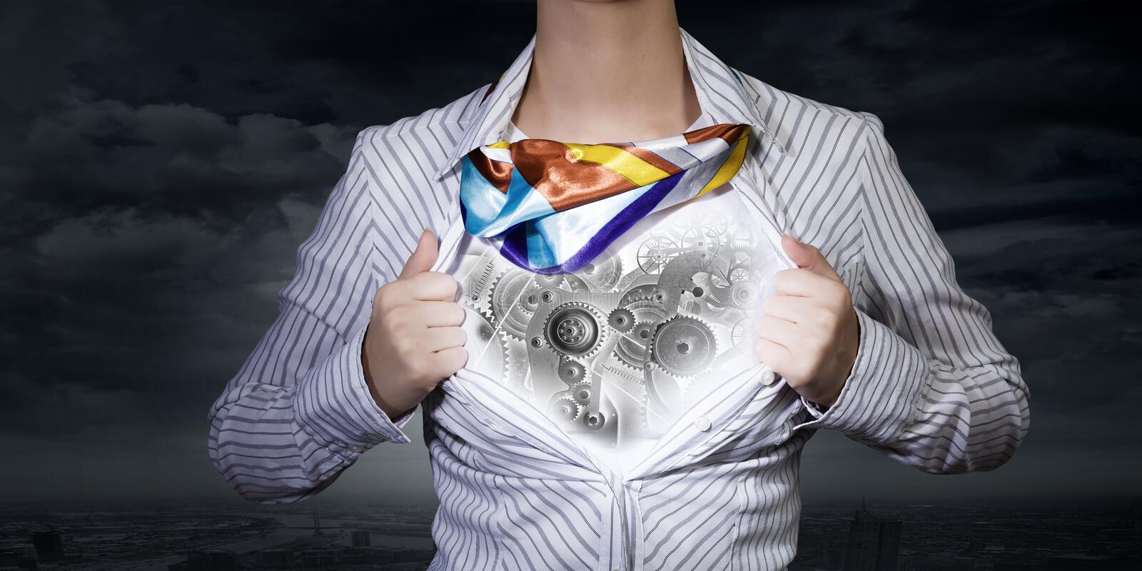 Super woman. Young woman tearing shirt on chest. Mechanism concept stock photos