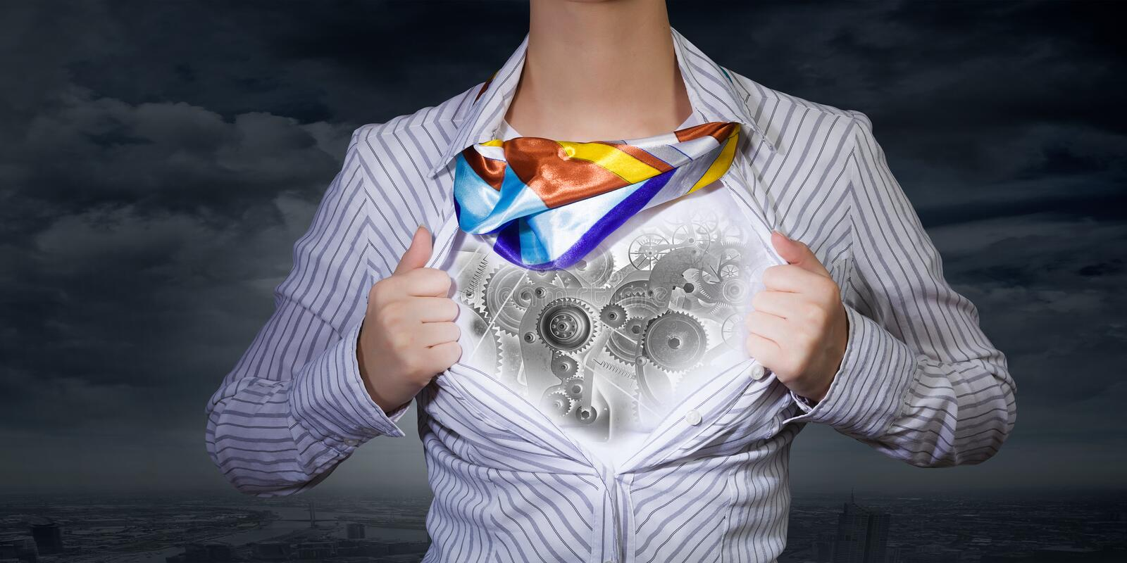 Super woman. Young woman tearing shirt on chest. Mechanism concept stock images