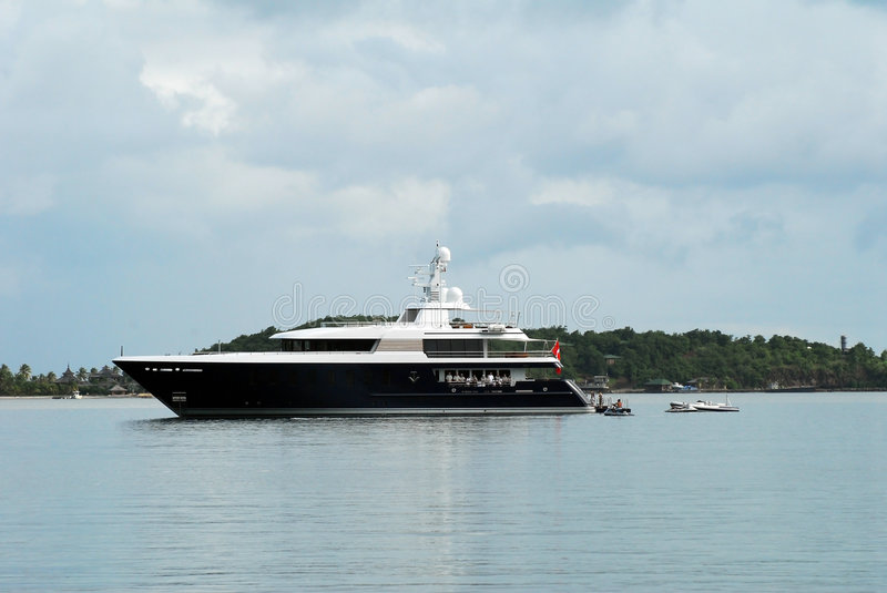 Super Yacht. Blue super yacht on charter in Caribbean with guests and crew onboard royalty free stock image