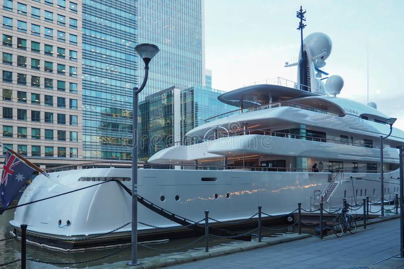 Super Yacht Ilona moored in West India Dock in Canary Wharf, City of London. Super Yacht Ilona belonging to Frank Lowy moored in West India Dock in Canary Wharf royalty free stock photos