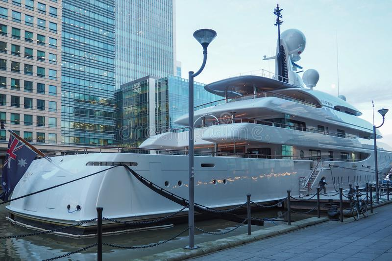 Super Yacht Ilona moored in West India Dock in Canary Wharf, City of London. Super Yacht Ilona belonging to Frank Lowy moored in West India Dock in Canary Wharf stock images