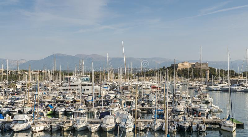 Super yacts at Port Vauban in Antibes, France with Fort Carré in the background.  stock photos