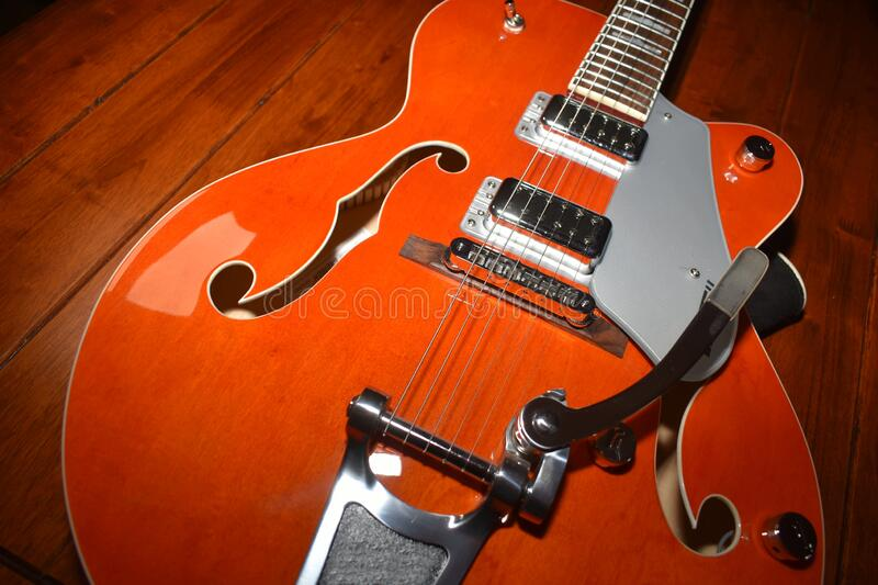 Superb electro-acoustic guitar ready to be played. On a wooden table royalty free stock photo