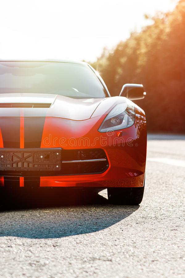 Red sport car close up. A supercar also called exotic car stock image