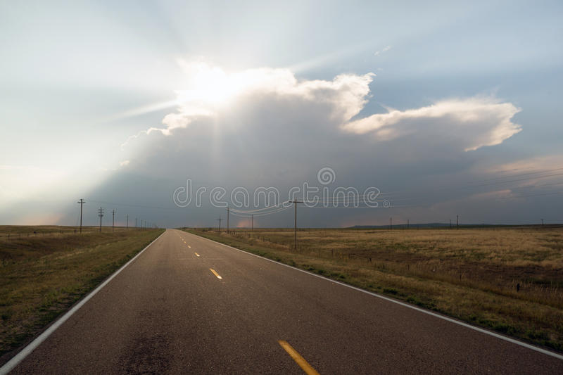 Supercell Storm Blocks out the Sun Rural Road Highway royalty free stock photos