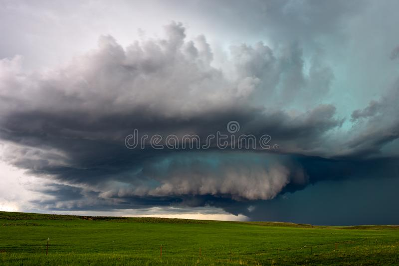 Supercell thunderstorm with ominous dark clouds stock photo