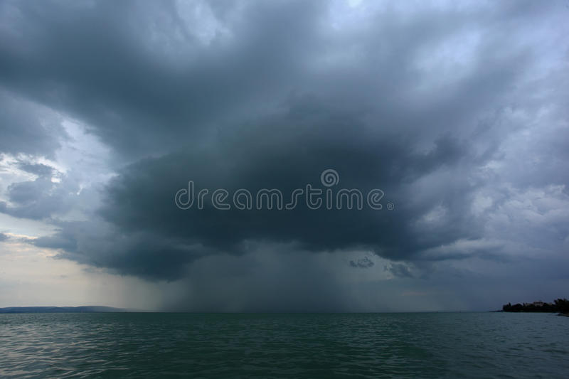 Supercell. Thunderstrom foorming above water surface royalty free stock photography