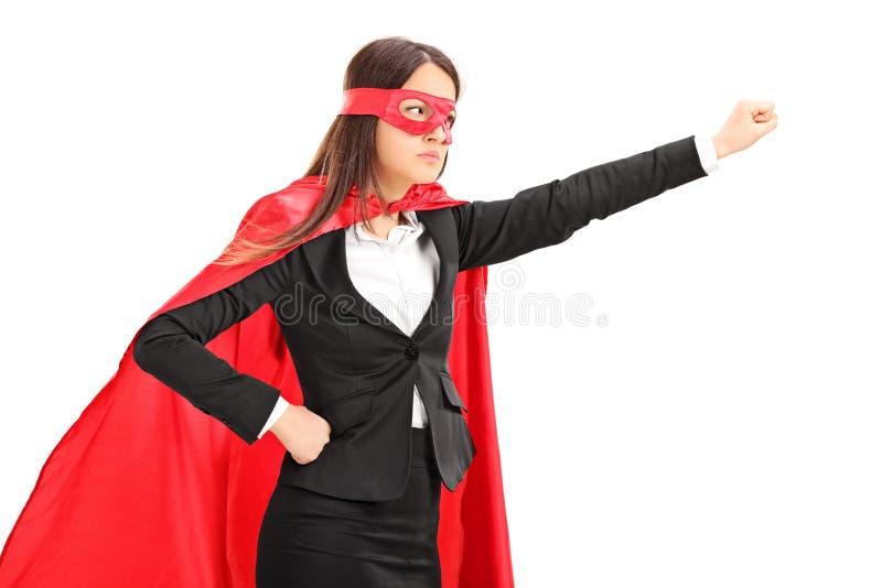 Supereroe femminile con il pugno afferrato fotografia stock