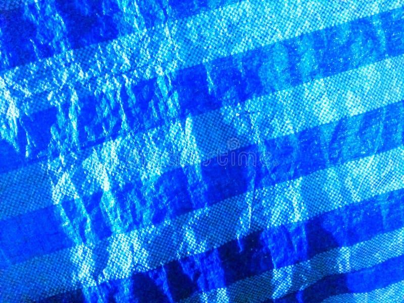 Superfície azul da lona e linhas diagonais modeladas fotografia de stock