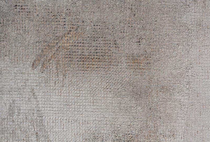 Superfície cinzenta resistida da parede do cimento da cor fotos de stock