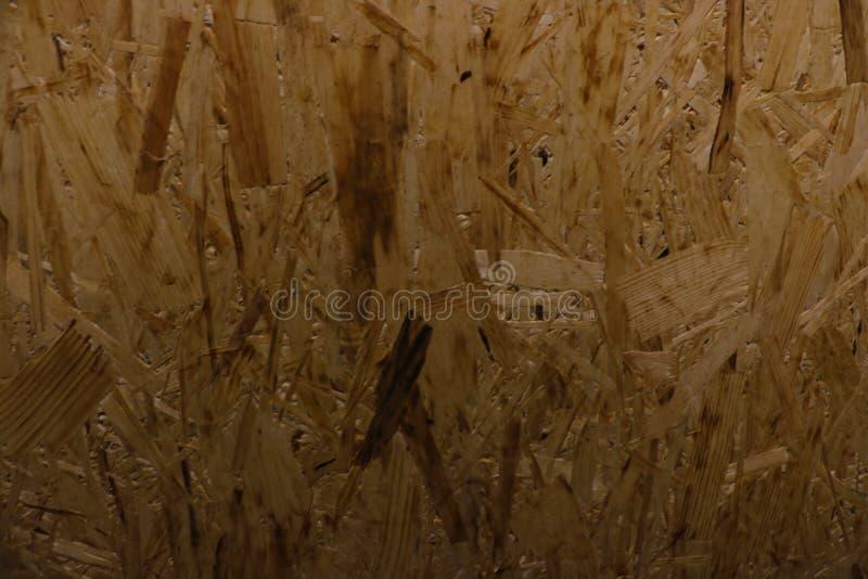 Superfície da placa derapagem pressionada feita das sobras do processamento de uma árvore foto de stock