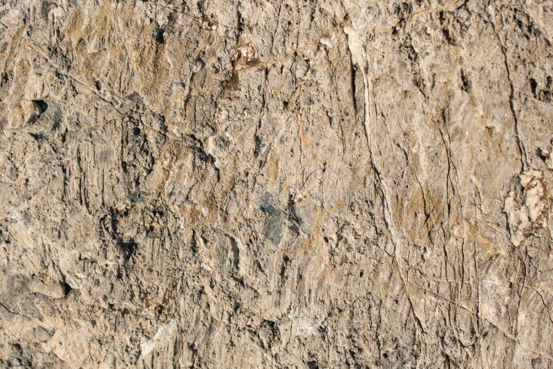 Superfície da rocha ou da pedra como a textura do fundo fotografia de stock royalty free