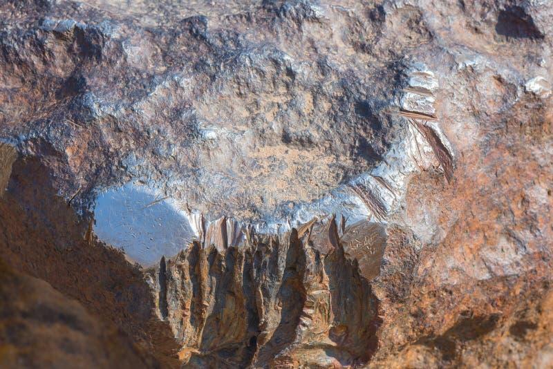 Superfície de incandescência Polished do meteorito, composta por metais pesados, na maior parte pelo ferro e pelo níquel high-den foto de stock