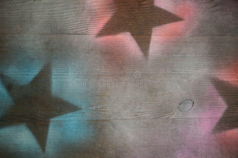 A superfície de madeira com estrelas pintadas mostra em silhueta o projeto colocado liso do fundo imagem de stock royalty free