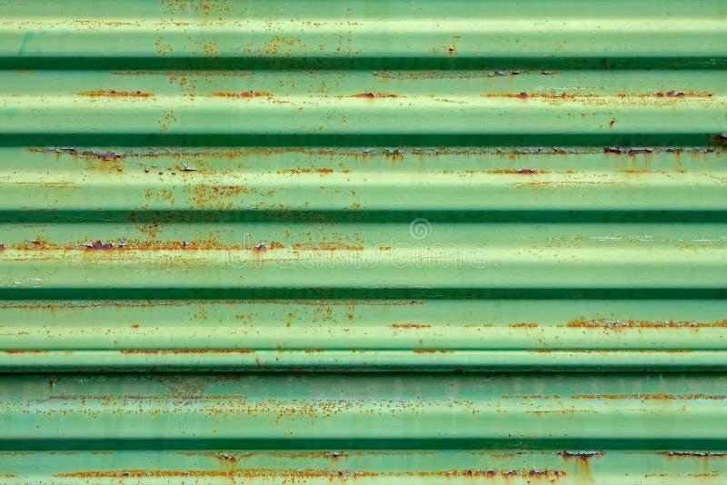 Superfície de metal oxidada pintada no verde fotos de stock