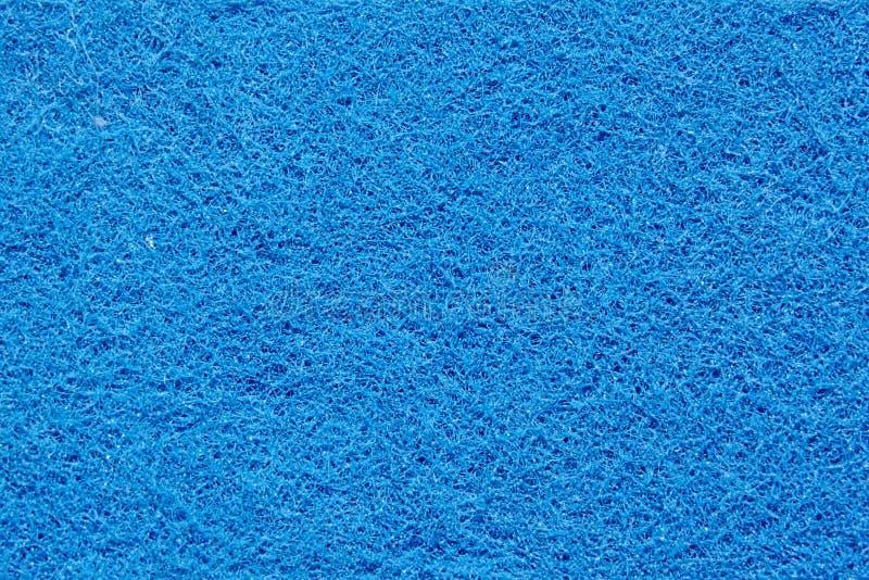 A superfície de uma esponja azul imagens de stock royalty free