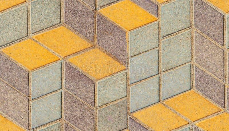 Superfície do assoalho emplastrado velho com rombo simétrico da arquitetura geométrica amarela azul colorida ou teste padrão repe imagem de stock