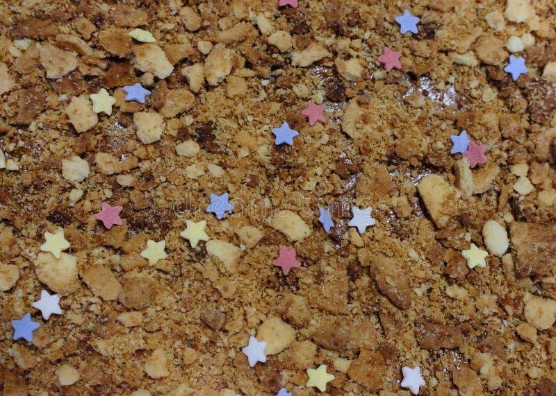 Superfície do bolo do biscoito amanteigado com doces das estrelas Cookies imagem de stock royalty free