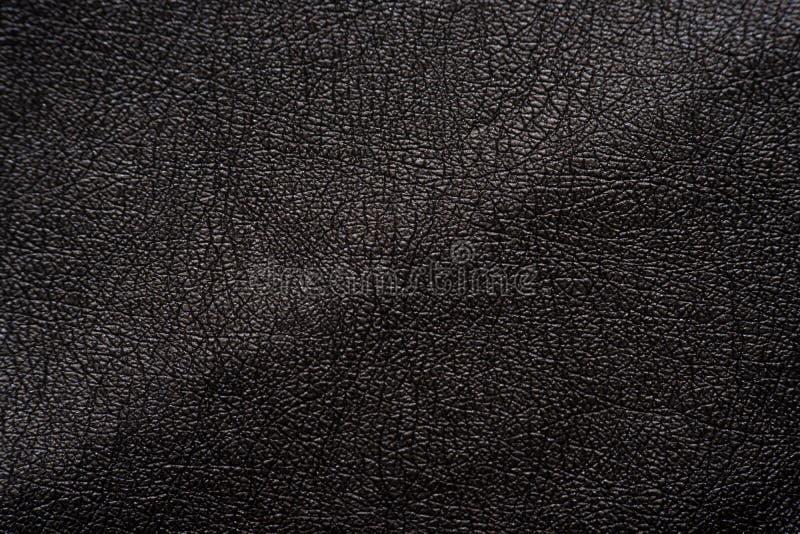 Superfície do fundo da textura do couro de Brown imagens de stock royalty free