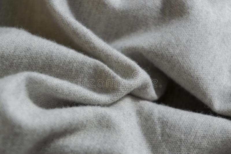 Superfície natural orgânica de tecido de algodão cinzento, ondulado e reticulado, fundo de textura fotos de stock