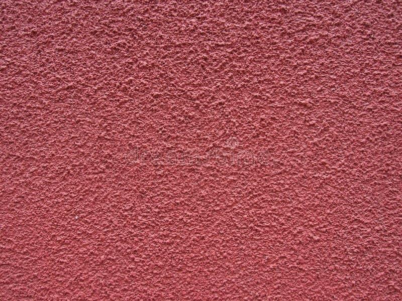 Superfície pintada textured áspera desvanecida do muro de cimento do rosa escuro vermelho fotos de stock