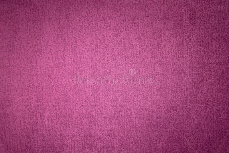 Superfície Textured do fundo do close-up da mobília de estofamento de matéria têxtil estrutura magenta da tela da cor vermelha foto de stock royalty free