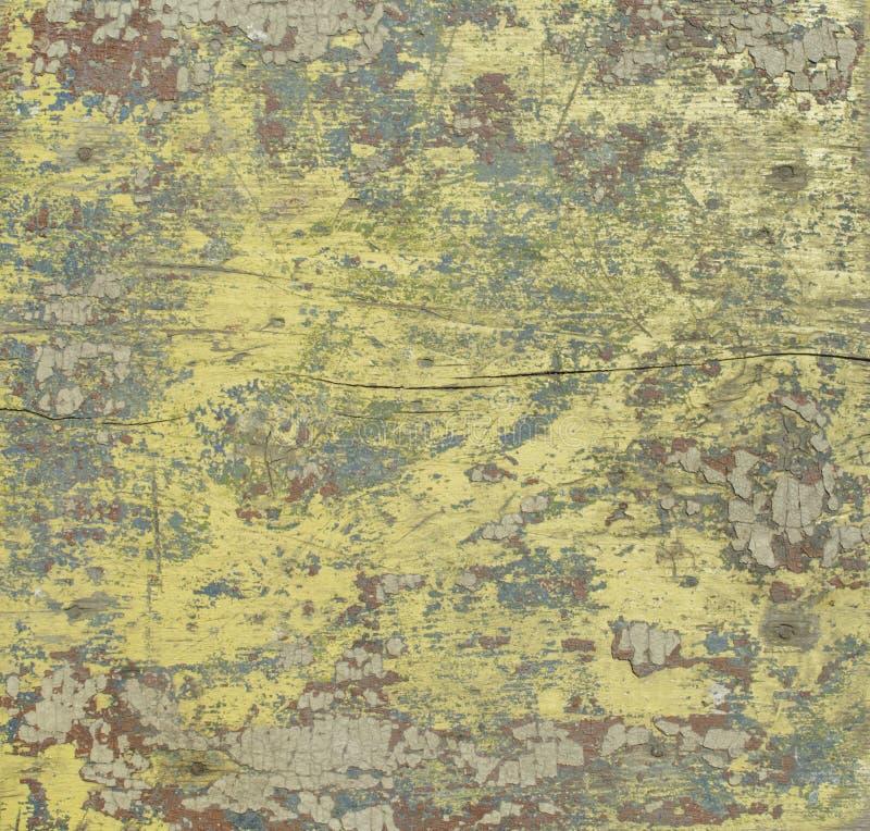 Superfície velha da madeira com pintura descascada, pintura diferente das cores na placa do vintage fotos de stock royalty free