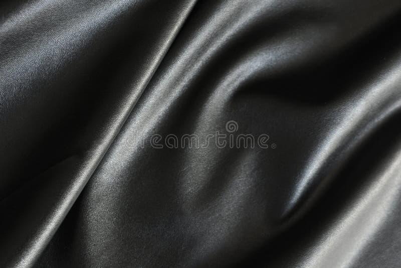 Superficie brillante, sedosa y lisa de la tela negra imagenes de archivo