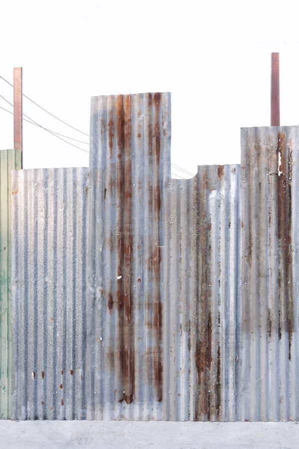 Superficie de acero galvanizada acanalada oxidada de la hoja de metal de la pared o del hierro para la textura y el fondo imagen de archivo libre de regalías