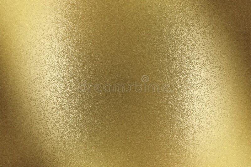 Superficie de bronce cepillada de la pared del metal que brilla intensamente, fondo abstracto de la textura imágenes de archivo libres de regalías