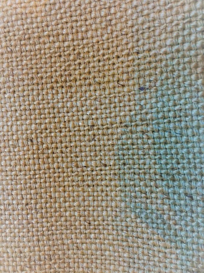 Superficie de Grey Polyester Fabric o despido coloreado natural de la arpillera para el fondo del color beige fotografía de archivo